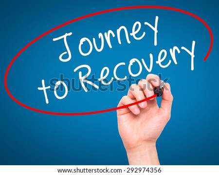 Man Hand writing Journey to Recovery with black marker on visual screen. Isolated on blue. Life, technology, internet concept. Stock Image - stock photo