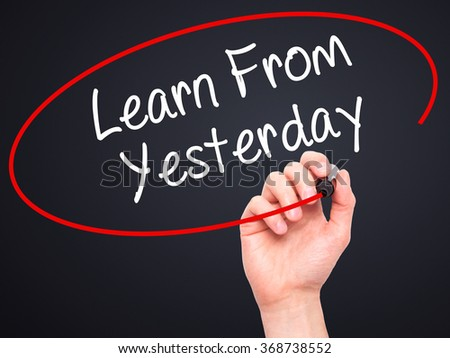 Man Hand writing Learn From Yesterday with black marker on visual screen. Isolated on background. Business, technology, internet concept. Stock Photo