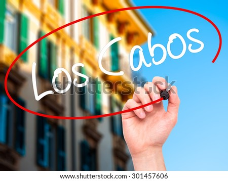Man Hand writing Los Cabos with black marker on visual screen. Isolated on city. Business, technology, internet concept. Stock Photo - stock photo