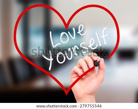 Man Hand writing Love Yourself with marker on transparent wipe board, inside heart shape. Isolated on office. Business, internet, technology concept. Stock Photo - stock photo