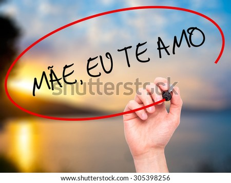 Man Hand writing MÃ?Â?E, EU TE AMO (Mother I Love You in Portuguese) with black marker on visual screen. Isolated on nature. Business, technology, internet concept. Stock Photo - stock photo