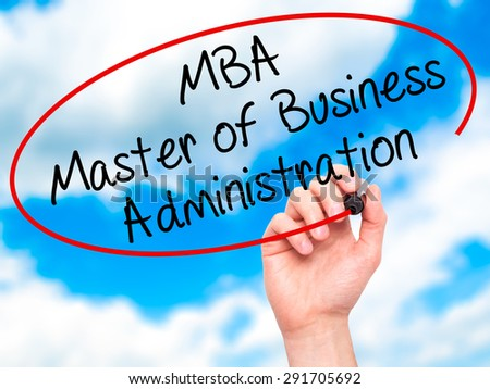 Man Hand writing MBA - Master of Business Administration with black marker on visual screen. Isolated on sky. Business, technology, internet concept. Stock Image
