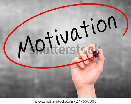 Man Hand writing Motivation with marker on transparent wipe board. Isolated on grey. Business, internet, technology concept.  Stock Photo - stock photo