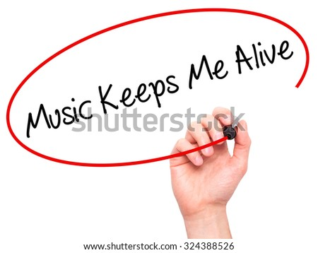 Man Hand writing Music Keeps Me Alive with black marker on visual screen. Isolated on white. Business, technology, internet concept. Stock Photo - stock photo