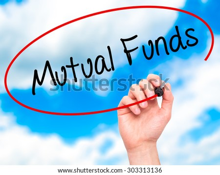 Man Hand writing Mutual Funds  with black marker on visual screen. Isolated on sky. Business, technology, internet concept. Stock Photo - stock photo
