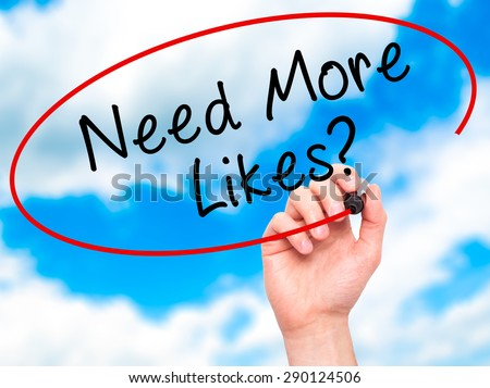 Man Hand writing Need More Likes? black marker on visual screen. Isolated on sky. Business, technology, internet concept. Stock Image - stock photo