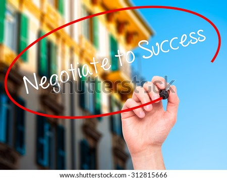Man Hand writing Negotiate to Success with black marker on visual screen. Isolated on city. Business, technology, internet concept. Stock Photo - stock photo