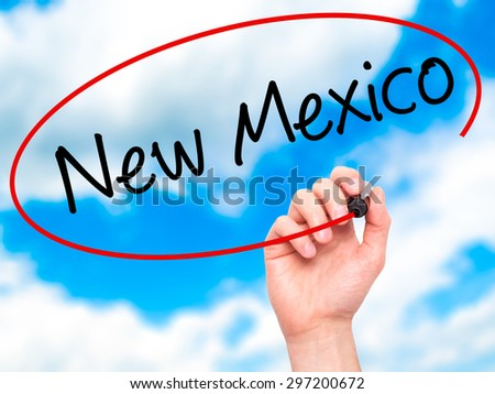Man Hand writing New Mexico with black marker on visual screen. Isolated on sky. Business, technology, internet concept. Stock Photo - stock photo