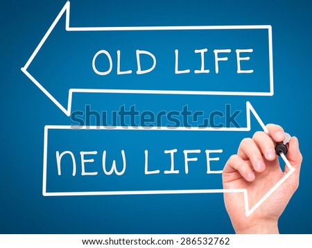 Man hand writing Old Life or New Life on visual screen. Business, help, internet, technology concept. Isolated on blue. Stock Photo - stock photo