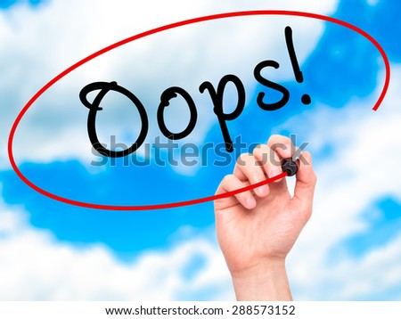 Man Hand writing Oops! with black marker on visual screen. Isolated on sky. Business, technology, internet concept. Stock Image - stock photo