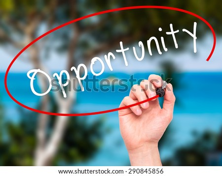 Man Hand writing Opportunity with black marker on visual screen. Isolated on nature. Business, technology, internet concept. Stock Image - stock photo