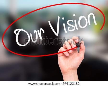 Man Hand writing Our Vision with black marker on visual screen. Isolated on office. Business, technology, internet concept. Stock Photo - stock photo