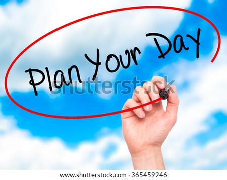 Man Hand writing Plan Your Day with black marker on visual screen. Isolated on background. Business, technology, internet concept. Stock Photo - stock photo