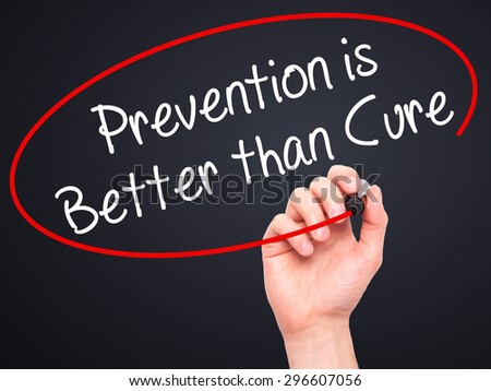 Man Hand writing Prevention is Better than Cure with black marker on visual screen. Isolated on black. Business, technology, internet concept. Stock Photo