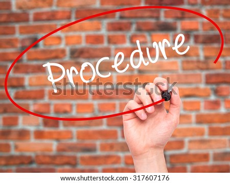 Man Hand writing Procedure with black marker on visual screen. Isolated on bricks. Business, technology, internet concept. - stock photo