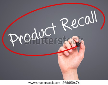 Man Hand writing Product Recall with black marker on visual screen. Isolated on grey. Business, technology, internet concept. Stock Photo - stock photo