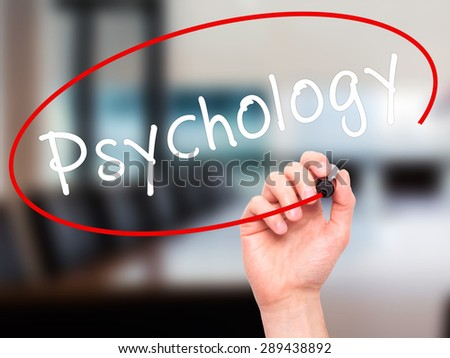 Man Hand writing Psychology with black marker on visual screen. Isolated on office. Business, technology, internet concept. Stock Image - stock photo