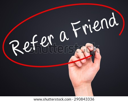 Man Hand writing Refer a Friend  with black marker on visual screen. Isolated on black. Business, technology, internet concept. Stock Image - stock photo