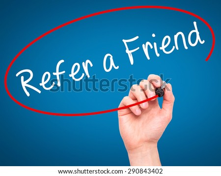 Man Hand writing Refer a Friend  with black marker on visual screen. Isolated on blue. Business, technology, internet concept. Stock Image - stock photo