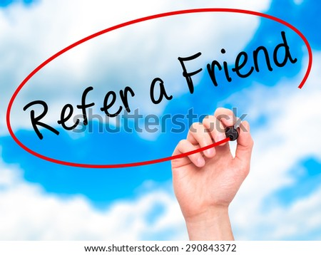 Man Hand writing Refer a Friend  with black marker on visual screen. Isolated on sky. Business, technology, internet concept. Stock Image - stock photo
