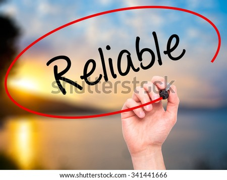 Man Hand writing Reliable with black marker on visual screen. Isolated on nature. Business, technology, internet concept. Stock Photo - stock photo