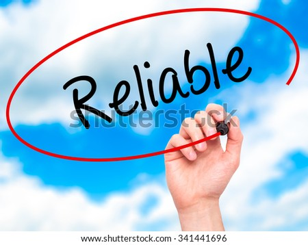 Man Hand writing Reliable with black marker on visual screen. Isolated on sky. Business, technology, internet concept. Stock Photo - stock photo
