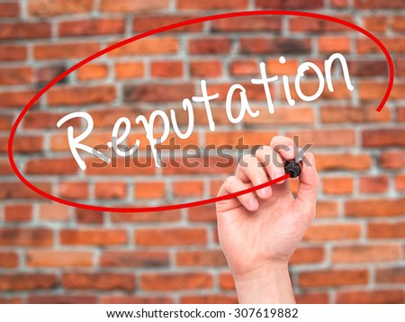 Man Hand writing Reputation with black marker on visual screen. Isolated on bricks. Business, technology, internet concept. Stock Photo - stock photo