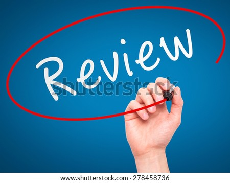 Man Hand writing Review with marker on transparent wipe board. Isolated on blue. Business, internet, technology concept. Stock Photo - stock photo