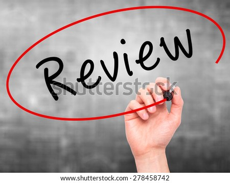 Man Hand writing Review with marker on transparent wipe board. Isolated on grey. Business, internet, technology concept. Stock Photo - stock photo