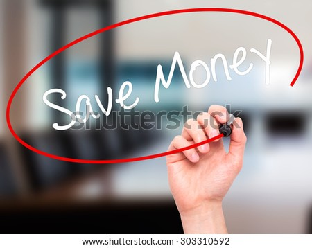 Man Hand writing Save Money with black marker on visual screen. Isolated on office. Business, technology, internet concept. Stock Photo - stock photo