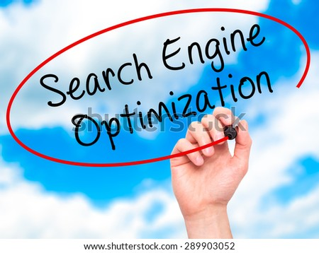 Man Hand writing Search Engine Optimization with black marker on visual screen. Isolated on sky. Business, technology, internet concept. Stock Image - stock photo