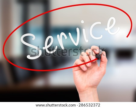Man hand writing Service on visual screen. Business,help, internet, technology concept. Isolated on office. Stock Photo - stock photo