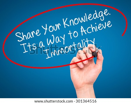 Man Hand writing Share Your Knowledge. Its a Way to Achieve Immortality with black marker on visual screen. Isolated on blue. Business, technology, internet concept. Stock Photo