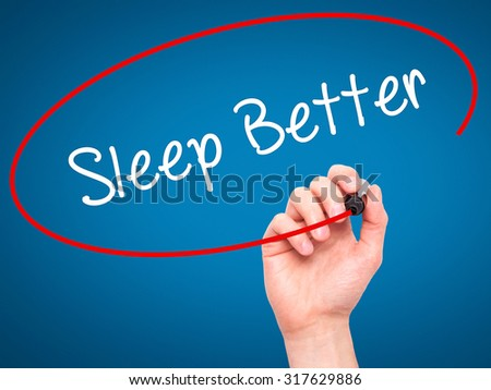 Man Hand writing Sleep Better with black marker on visual screen. Isolated on blue. Business, technology, internet concept. - stock photo