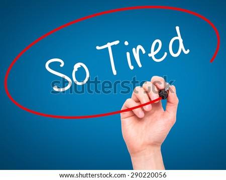 Man Hand writing So Tired with black marker on visual screen. Isolated on blue. Business, technology, internet concept. Stock Image  - stock photo