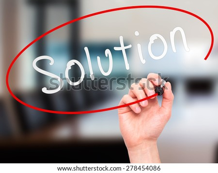 Man Hand writing Solution with marker on transparent wipe board. Isolated on office. Business, internet, technology concept.  Stock Photo - stock photo