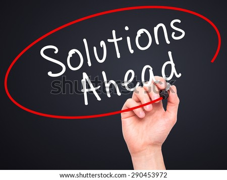 Man Hand writing Solutions Ahead with black marker on visual screen. Isolated on black. Learn, technology, internet concept. Stock Image - stock photo
