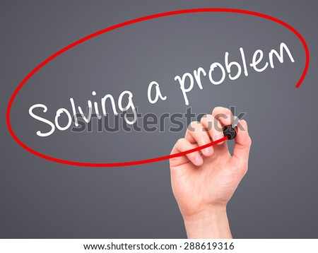 Man Hand writing Solving a problem with black marker on visual screen. Isolated on grey. Business, technology, internet concept. Stock Image - stock photo