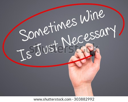 Man Hand writing Sometimes Wine Is Just Necessary with black marker on visual screen. Isolated on grey. Business, technology, internet concept. Stock Photo