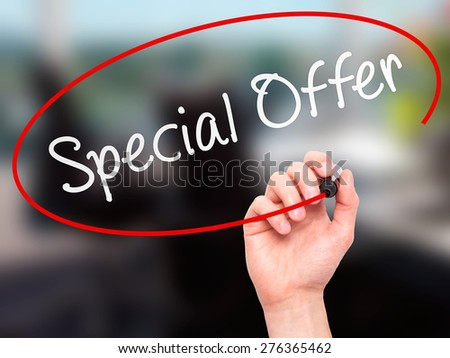 Man Hand writing Special Offer with marker on transparent wipe board. Isolated on office. Business, internet, technology concept.  Stock Photo - stock photo