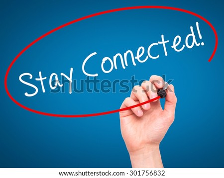Man Hand writing Stay Connected! with black marker on visual screen. Isolated on blue. Business, technology, internet concept. Stock Photo - stock photo