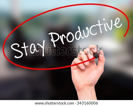 Man Hand writing Stay Productive with black marker on visual screen. Isolated on office. Business, technology, internet concept. Stock Photo - stock photo