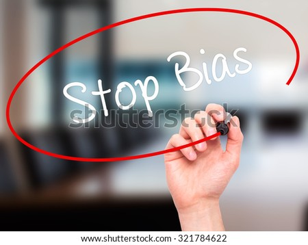 Man Hand writing Stop Bias with black marker on visual screen. Isolated on office. Business, technology, internet concept.  - stock photo