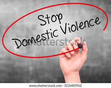 Man Hand writing  Stop Domestic Violence with black marker on visual screen. Isolated on grey. Business, technology, internet concept. Stock Photo - stock photo
