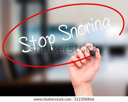 Man Hand writing Stop Snoring with black marker on visual screen. Isolated on office. Business, technology, internet concept. Stock Photo
