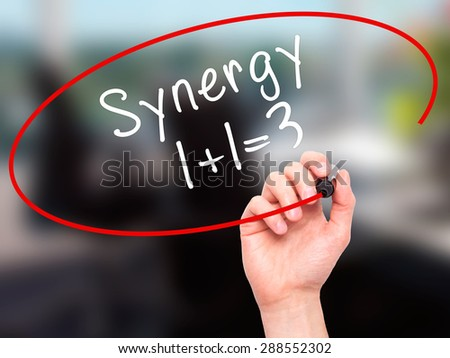 Man Hand writing Synergy concept 1+1=3 with black marker on visual screen. Isolated on office. Business, technology, internet concept. Stock Image - stock photo