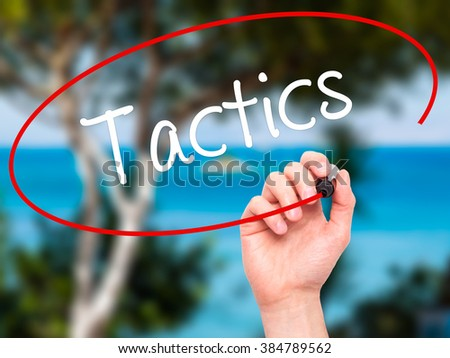 Man Hand writing Tactics with black marker on visual screen. Isolated on background. Business, technology, internet concept. Stock Photo - stock photo