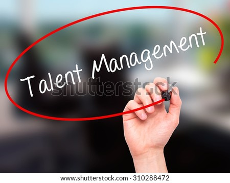 Man Hand writing Talent Management with black marker on visual screen. Isolated on office. Business, technology, internet concept. Stock Photo - stock photo