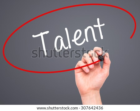 Man Hand writing Talent  with black marker on visual screen. Isolated on gry. Business, technology, internet concept. Stock Photo - stock photo