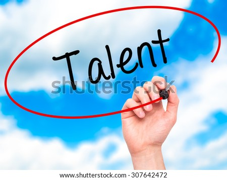 Man Hand writing Talent  with black marker on visual screen. Isolated on sky. Business, technology, internet concept. Stock Photo - stock photo